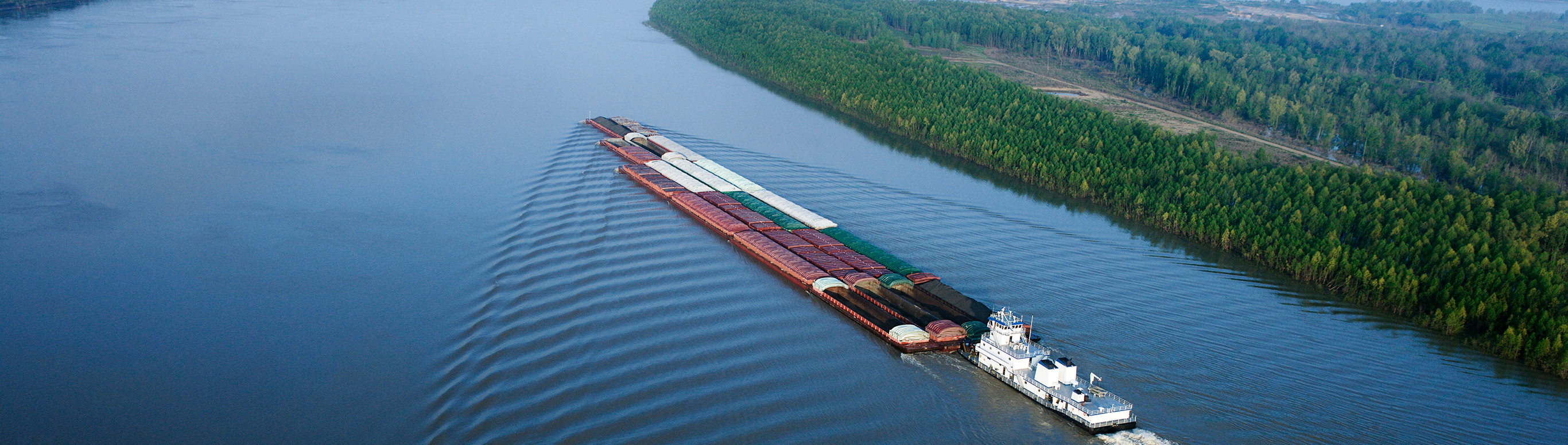 towboat pushing barge on Mississippi River near St. Louis