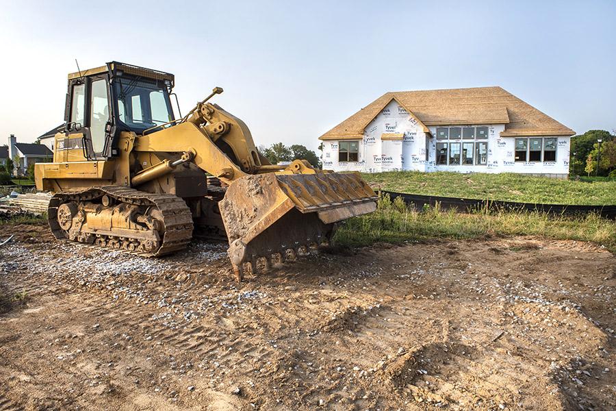 bulldozer construction jobsite under security camera watch