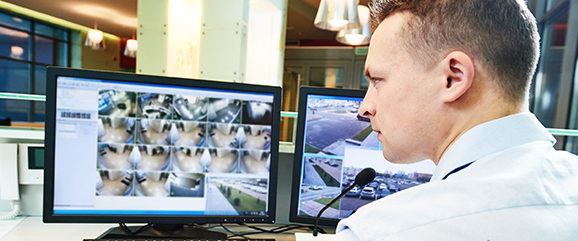 security guard monitoring video screen