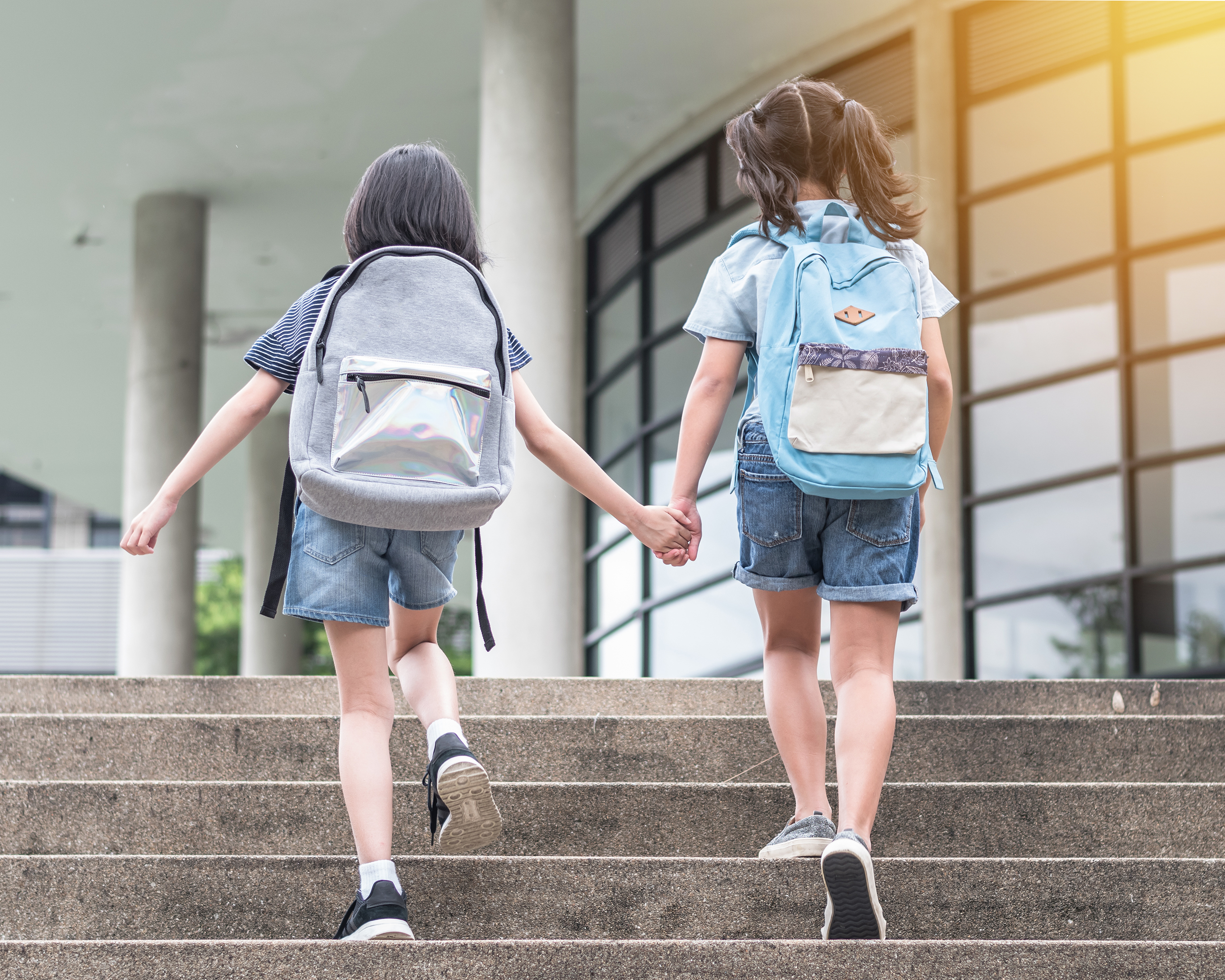 two young female students walking to school