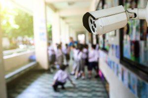video surveillance security camera in school hallway
